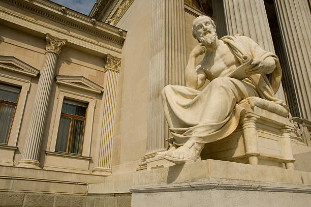 Statue of sitting philosopher on chair