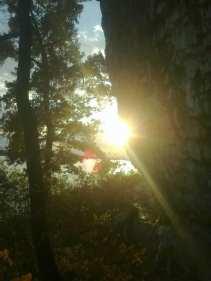 Sun by rock