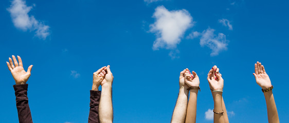 Raised hands in praise