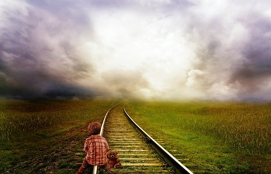 Boy on traintrack