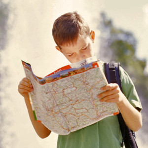 Boy studying map