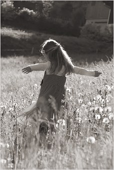 Girl dancing in field