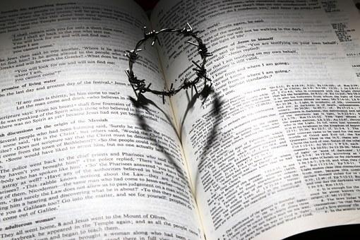 Cross heart on bible