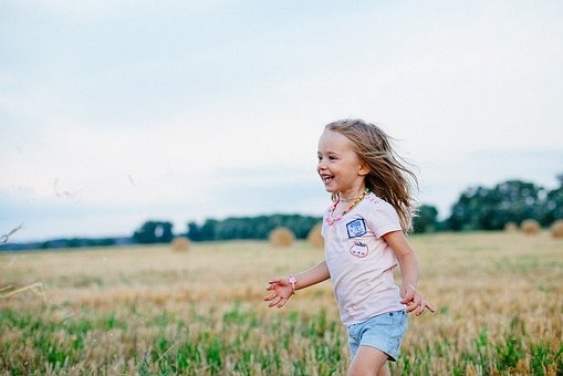 Girl smiling in field