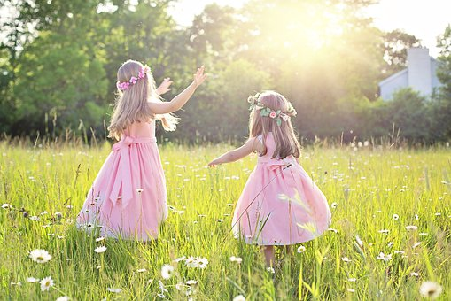 Little girls in field