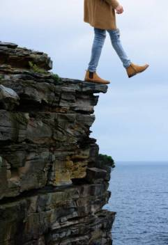 Man stepping of cliff