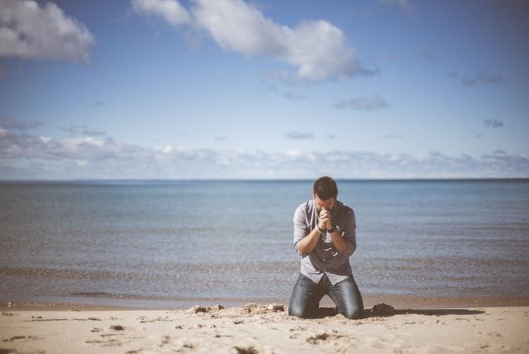 Kneeling on a beach