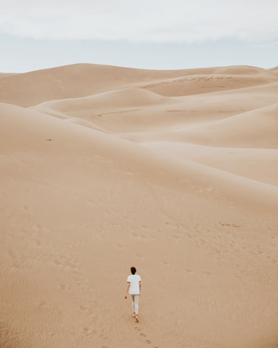 Walking on a sand dune