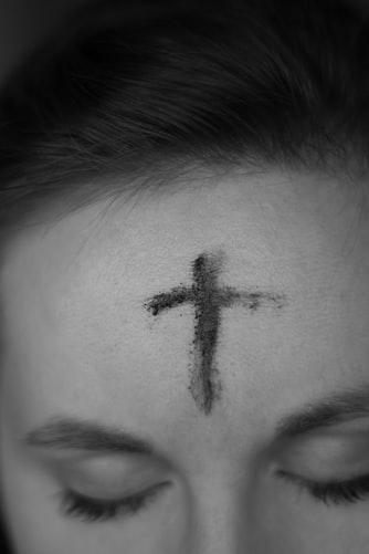 Cross on forehead