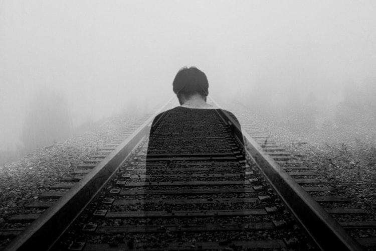 Faded person on railroad