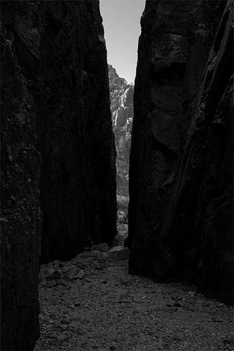 Gap in rock wall