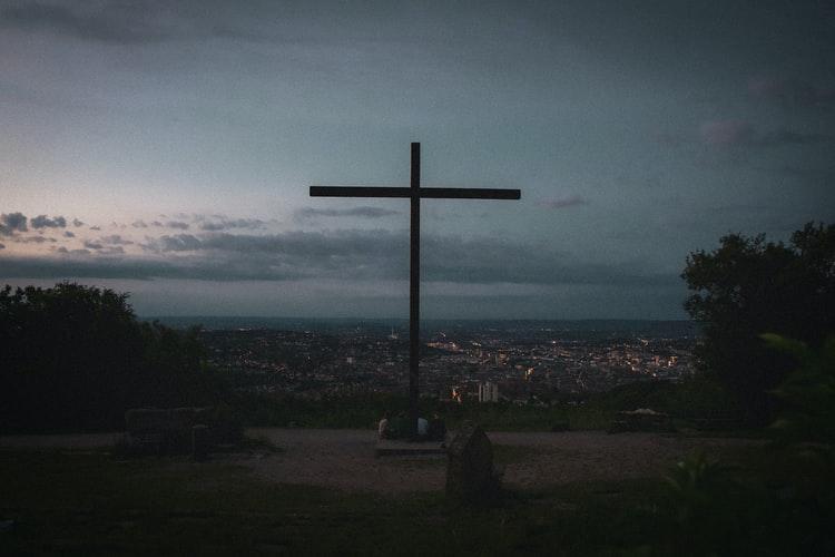 Cross overlooking a city
