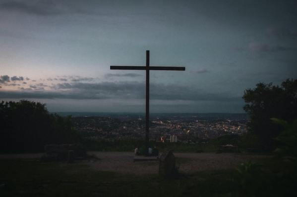 Cross overlooking a city